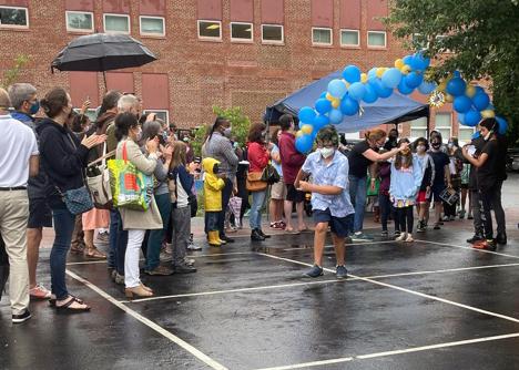 Aidan King runs through clapping parents at 5th Grade Celebration
