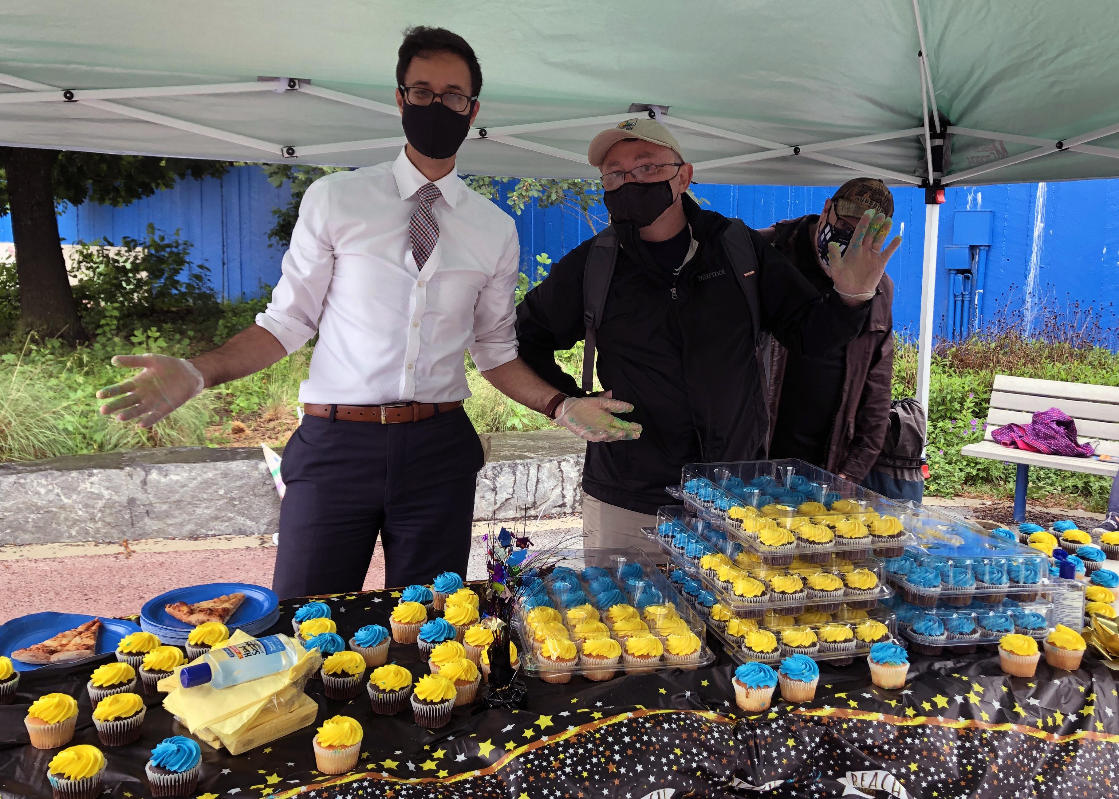 Akbar and Paul serve cupcakes at 5th Grade Celebration