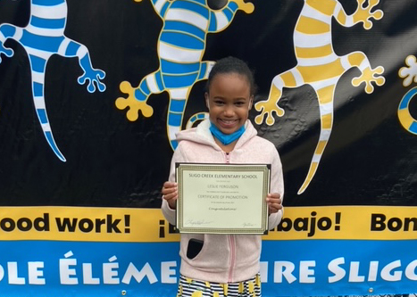 Leslie F with certificate at 5th Grade Celebration
