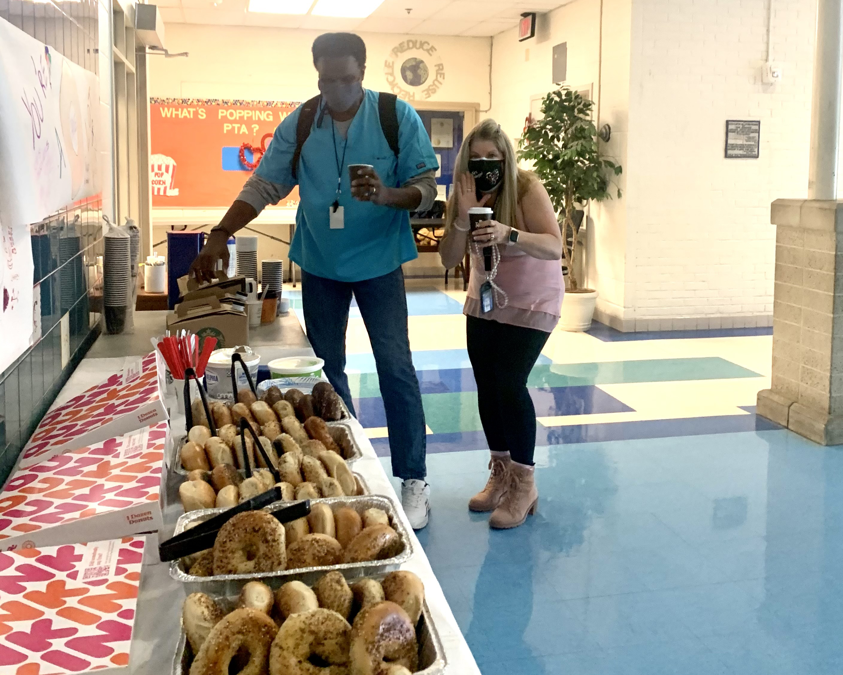 Mr. B and Mrs. H pick up bagels and coffee during Teacher Appreciation Week